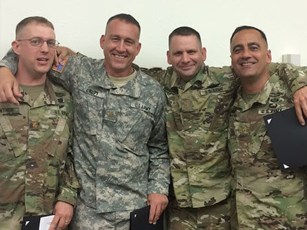 Four people wearing camouflage - Lieutenant Colonel Brian V. Crupi's military service