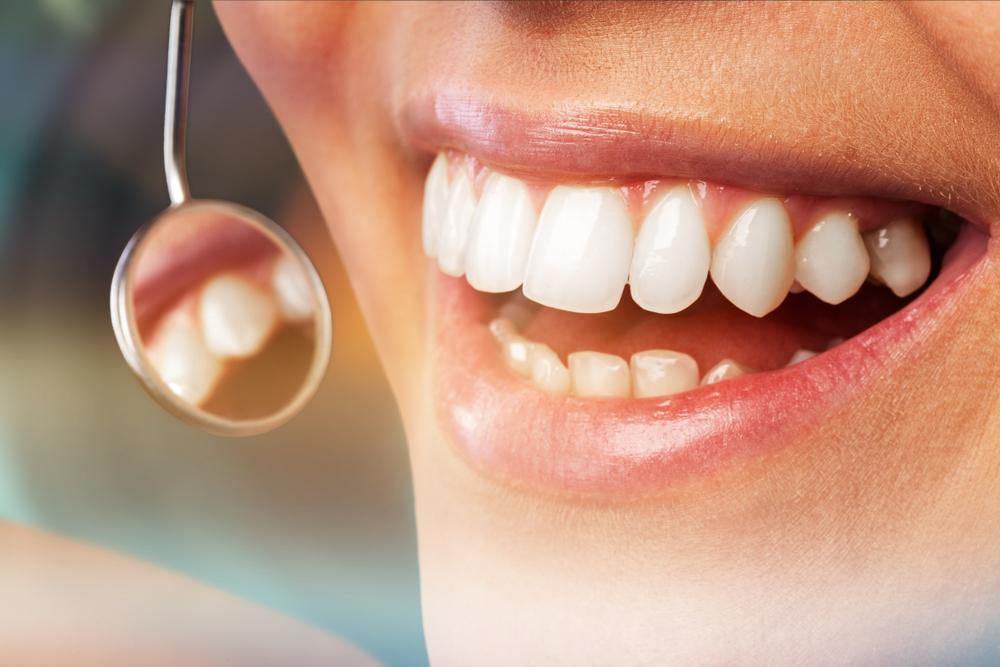 dentist examining a patient's gums